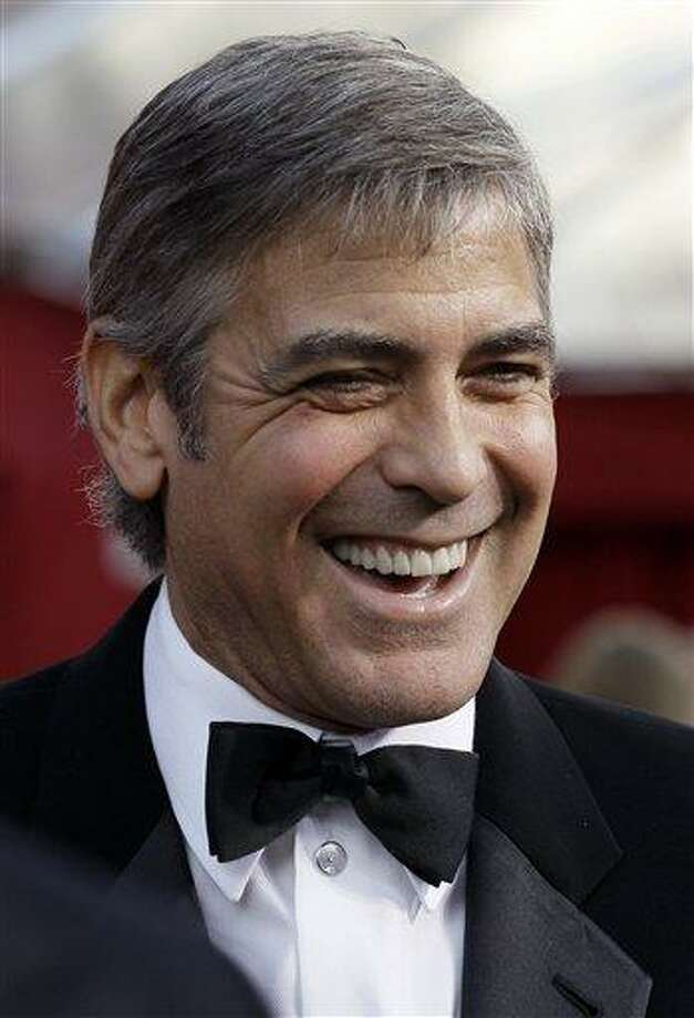 FILE - George Clooney arrives at the 82nd Academy Awards in this  March 7, 2010 file photo taken in the Hollywood section of Los Angeles. The Academy of Television Arts and Sciences announced it will present the 49-year-old actor with its Bob Hope Humanitarian Award at the Emmy ceremony next month. (AP Photo/Amy Sancetta, File) Photo: AP / AP2010