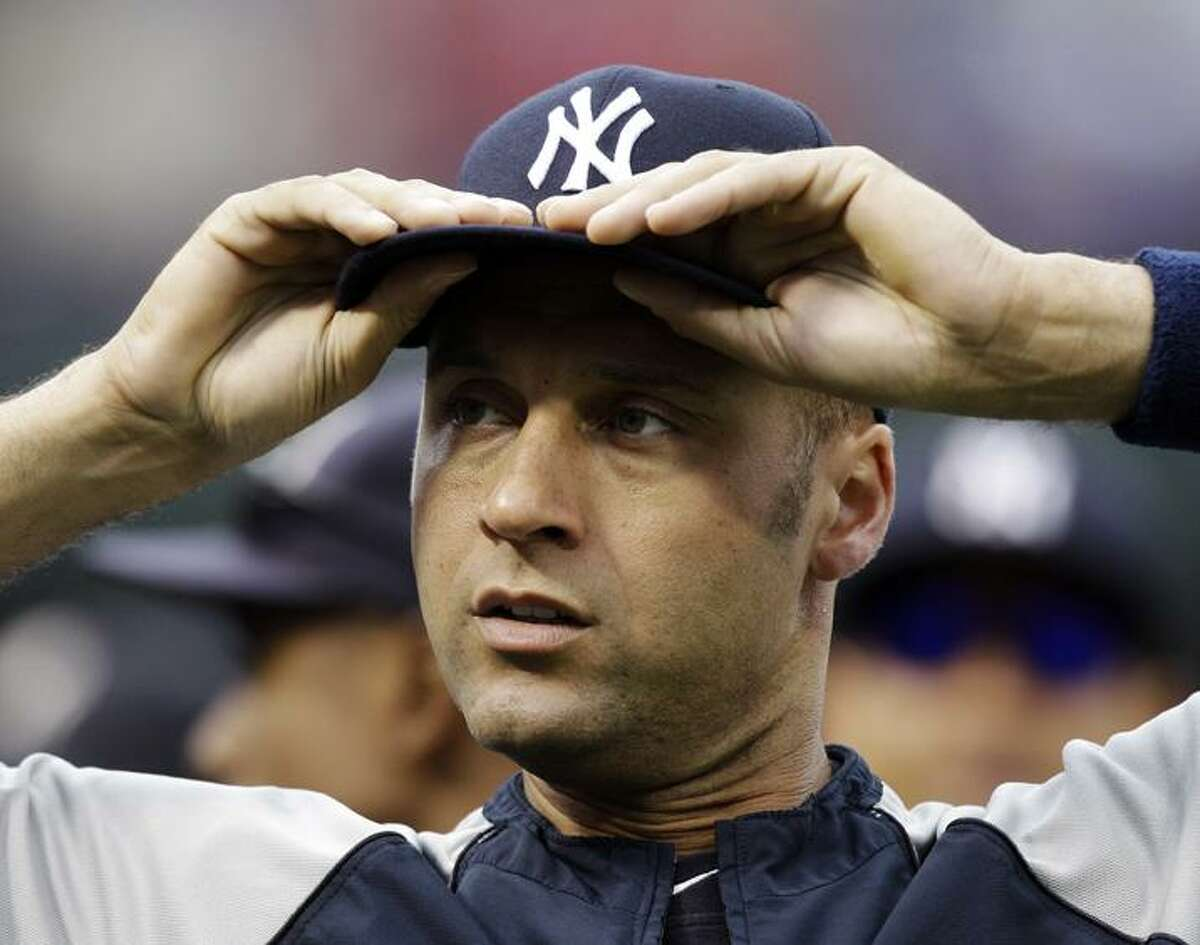 New York Yankees' Derek Jeter adjusts his cap during batting practice before Game 6 of baseball's American League Championship Series against the Texas Rangers Friday, Oct. 22, 2010, in Arlington, Texas. (AP Photo/Chris O'Meara)