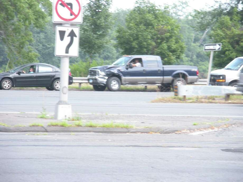 The front end of a blue pickup truck suffered damage in a two-car crash on Route 9 about 1:30 p.m. today.
