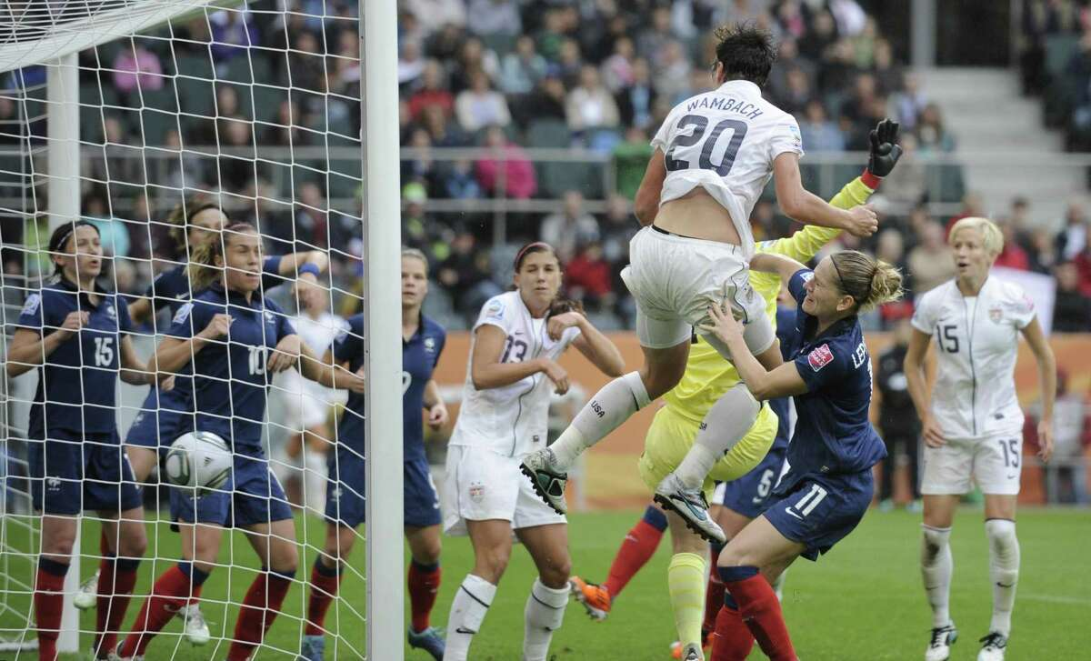 United States' Abby Wambach scores her side's second goal during the semifinal match between France and the United States at the Women's Soccer World Cup in Moenchengladbach, Germany, Wednesday, July 13, 2011. (AP Photo/Martin Meissner)