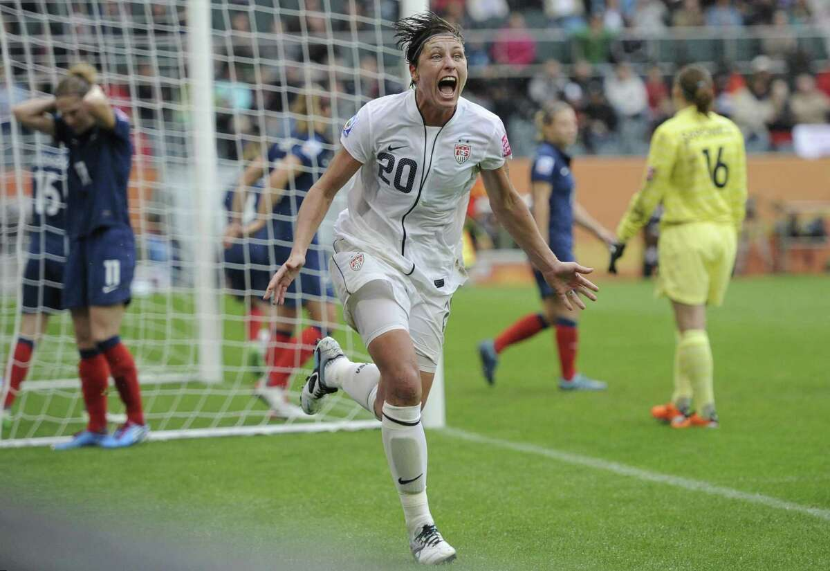 United States' Abby Wambach celebrates scoring her side's 2nd goal during the semifinal match between France and the United States at the Women's Soccer World Cup in Moenchengladbach, Germany, Wednesday, July 13, 2011. (AP Photo/Martin Meissner)