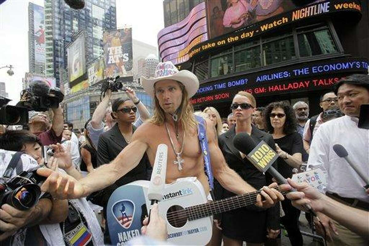 FILE - In this July 22, 2009 file photo, Robert Burck, also known as The Naked Cowboy, speaks to reporters during a news conference in New York's Times Square. One of Times Square's best-known entertainers is heading to court to protect his trademark. The Naked Cowboy is suing the Naked Cowgirl. (AP Photo/Mary Altaffer, File)