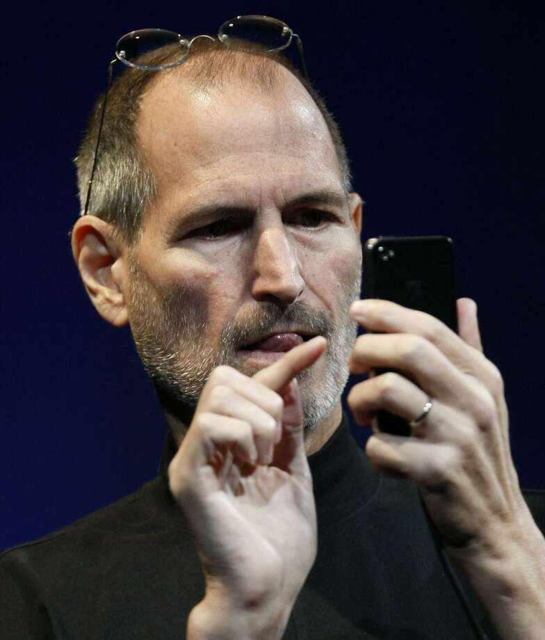 FILE - In this file photo taken June 7, Apple CEO Steve Jobs demonstrates the new iPhone 4 during the Apple Worldwide Developers Conference, in San Francisco. Apple Inc. is holding a press conference at its Silicon Valley headquarters Friday morning to talk about its latest iPhone model. (AP Photo/Paul Sakuma, File) Photo: ASSOCIATED PRESS / AP