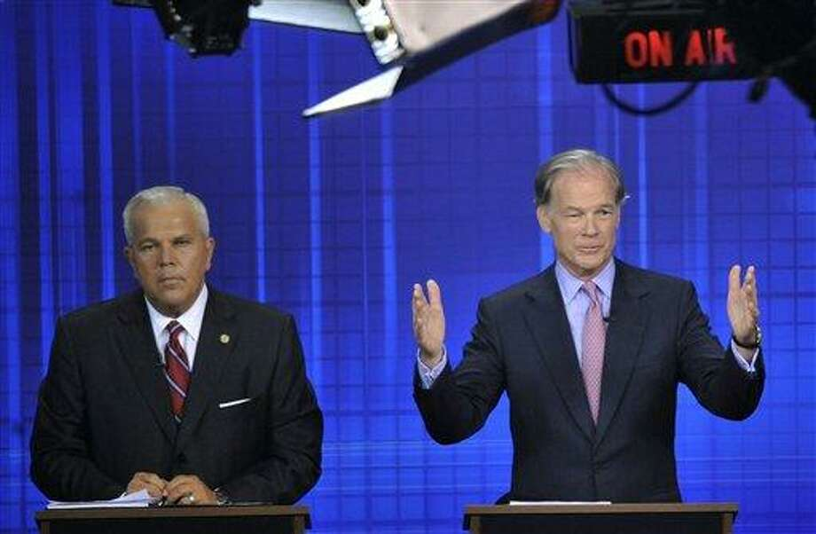 This July 14 file photograph shows Republican candidates for governor Tom Foley, right, gesturing, as Lt. Gov. Michael Fedele listens during a live televised debate in West Hartford. (AP) Photo: AP / FR125654 AP