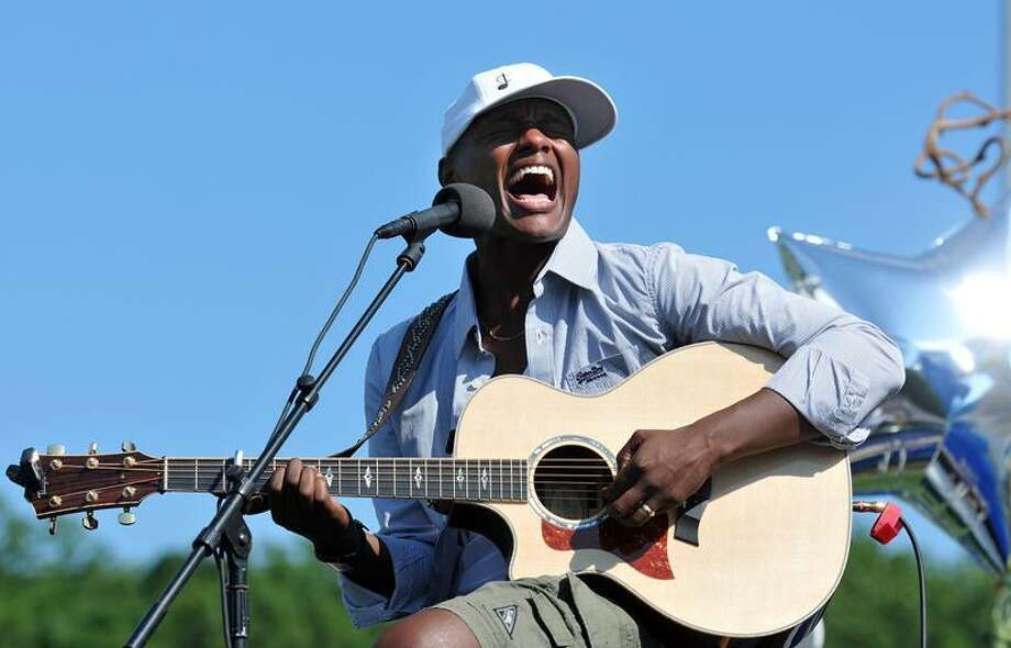 """Stratford-- Javier Colon, winner of NBC's """"The Voice"""" competition, sings for his hometown crowd at Bunnell High one week after winning the national competition.  Photo-Peter Casolino/New Haven RegisterCas110710   7/10/11"""