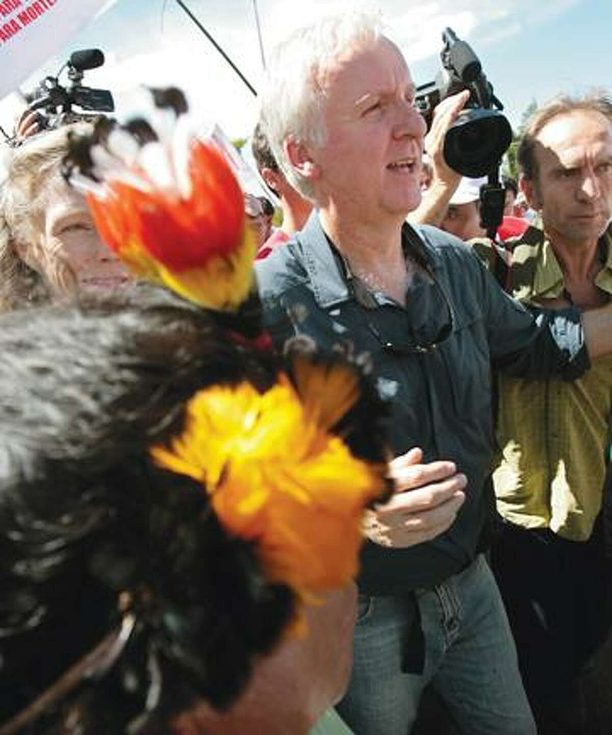 Director James Cameron marches during a protest against a proposed dam in the Amazon in Brasilia Monday. Brazil's government says the Belo Monte project will provide much-needed clean energy for the country. Indian groups say they will be displaced by the dam and environmentalists say its benefits won't make up for the damage to the jungle.(AP)