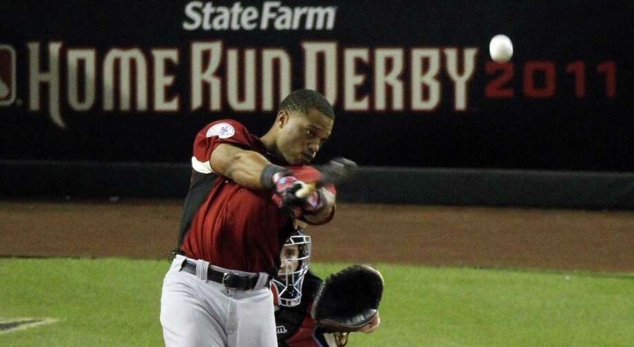 American League's Robinson Cano of the New York Yankees hits the winning home run at the MLB Home Run Derby Monday, July 11, 2011, in Phoenix. (AP Photo/Ross D. Franklin) Photo: ASSOCIATED PRESS / AP2011