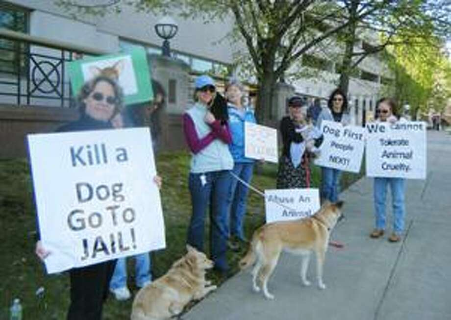 (Submitted photo) Members of Our Companions Domestic Animal Sanctuary and Connecticut Votes For Animals protest alleged dog killer Victor Serrano's court appearance outside Middletown Superior Court Thursday.