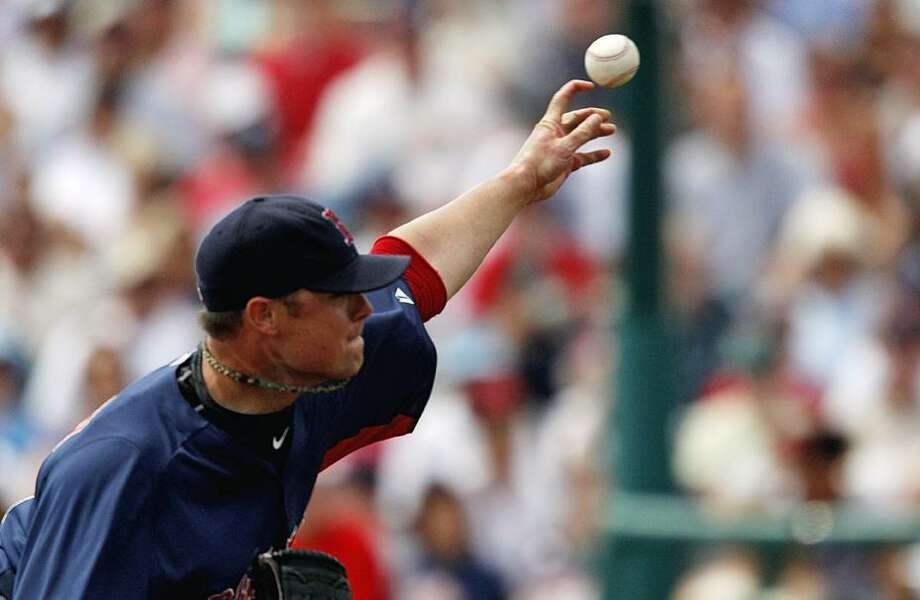 Boston Red Sox starting pitcher Jon Lester throws a pitch in the second inning of a spring training baseball game  against the Atlanta Braves Wednesday, March 16, 2011 in Kissimmee, Fla. Atlanta won 4-3. (AP Photo/David Goldman)