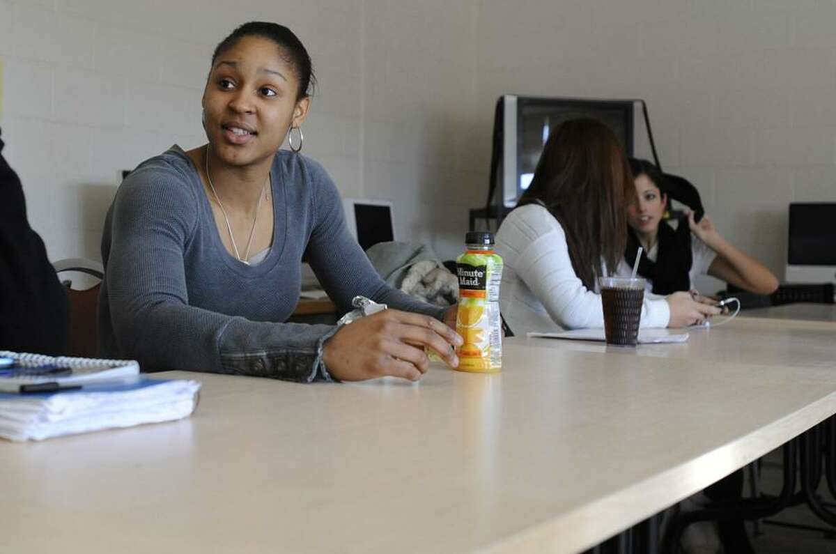 **HOLD FOR STORY BY DOUG FEINBERG** In this March 3, 2011 photo, Maya Moore sits in class on campus at the University of Connecticut in Storrs, Conn. (AP Photo/Jessica Hill)