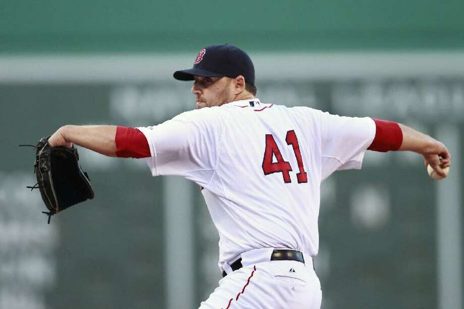 ASSOCIATED PRESS Boston Red Sox starting pitcher John Lackey throws in the first inning of Saturday's game against the Baltimore Orioles at Fenway Park in Boston. The Red Sox won 4-0 behind a solid effort from Lackey.