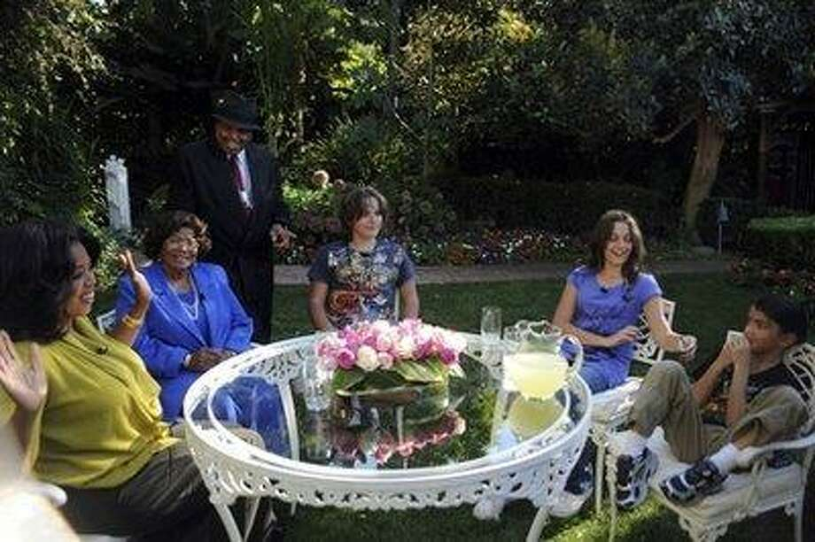"""In this photo taken Oct. 9, 2010 and provided by Harpo Productions Inc., talk-show host Oprah Winfrey, left,  is seen with the Jacksons, during an interview with Katherine Jackson, second from left, mother of the late pop star Michael Jackson, in a taping of """"The Oprah Winfrey Show"""" in Encino, Calf. Looking on are Joe Jackson, Michael's father, and Michael's three children from left, Prince, Paris and Blanket. (AP Photo/Harpo Productions INc, Robin Slayton) Photo: AP / (c) 2010 Harpo Productions, Inc./All Rights Reserved"""