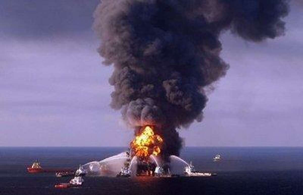 A US Coast Guard image of fire boat response crews as they battle the blazing remnants of the BP operated off shore oil rig, Deepwater Horizon, in the Gulf of Mexico, on April 21, 2010.