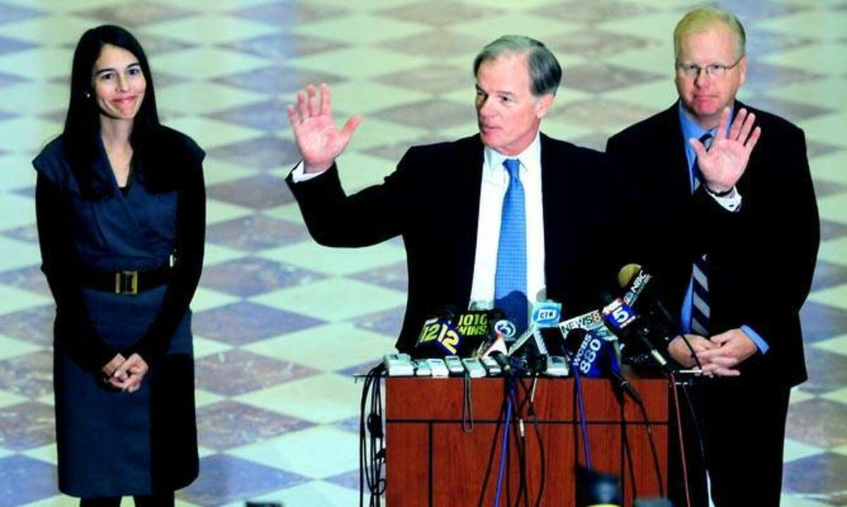HARTFORD - Tom Foley (center) ends a press conference where he conceded victory in the gubernatorial election to Dan Malloy at the Goodwin Hotel in Hartford on 11/8/10. At left is his wife, Leslie Fahrenkopf Foley, and at right is his running mate, Danbury Mayor Mark Boughton.Photo by Arnold Gold/New Haven Register AG0392A