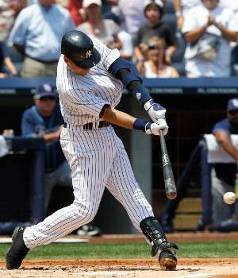 ASSOCIATED PRESS New York Yankees shortstop Derek Jeter follows through on a single during the first inning of Saturday's game against the Tampa Bay Rays at Yankee Stadium in New York. The hit was No. 2,999 for Jeter. Jeter homered in the third inning to reach 3,000 hits.