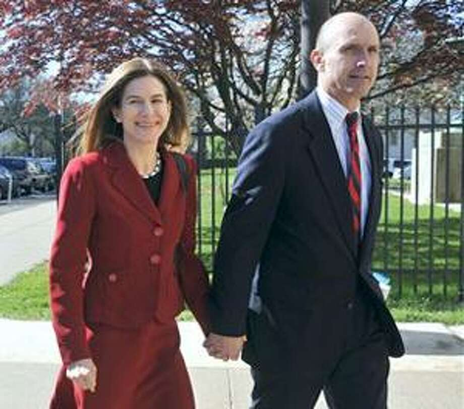 AP (AP) Connecticut Secretary of State Susan Bysiewicz, of Middletown, leaves Superior Court with her husband, David Donaldson, in Hartford Wednesday. Photo: AP / AP2010