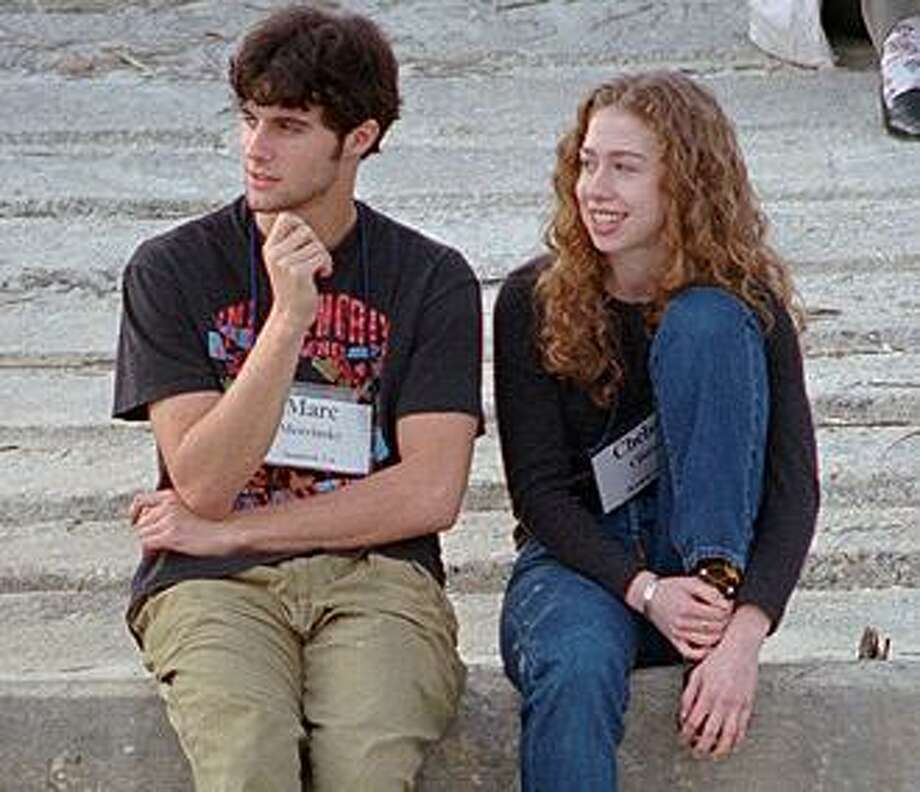 In this Dec. 1996 file photo, Chelsea Clinton, right, sits with Marc Mezvinsky on the beach at Hilton Head Island, S.C.  (AP Photo/Mary Ann Chastain, File) Photo: AP / AP