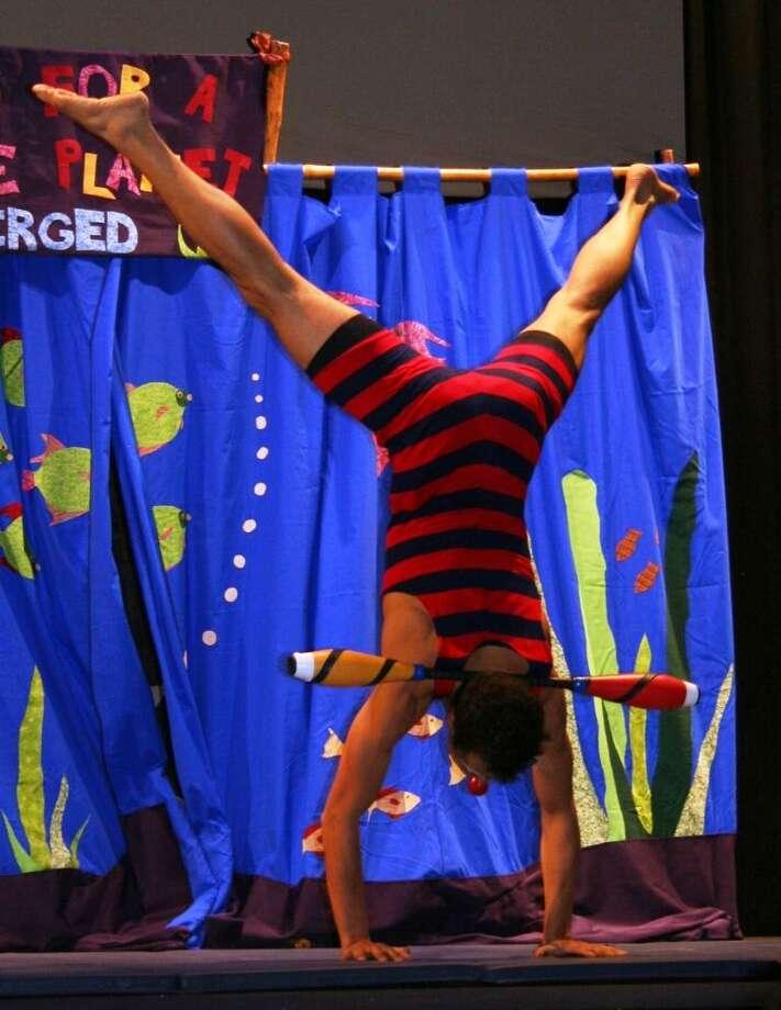 ARTFARM's Circus for a Fragile Planet SUBMERGED! performer Joel Melendez. Photo by Heidi Kirchofer