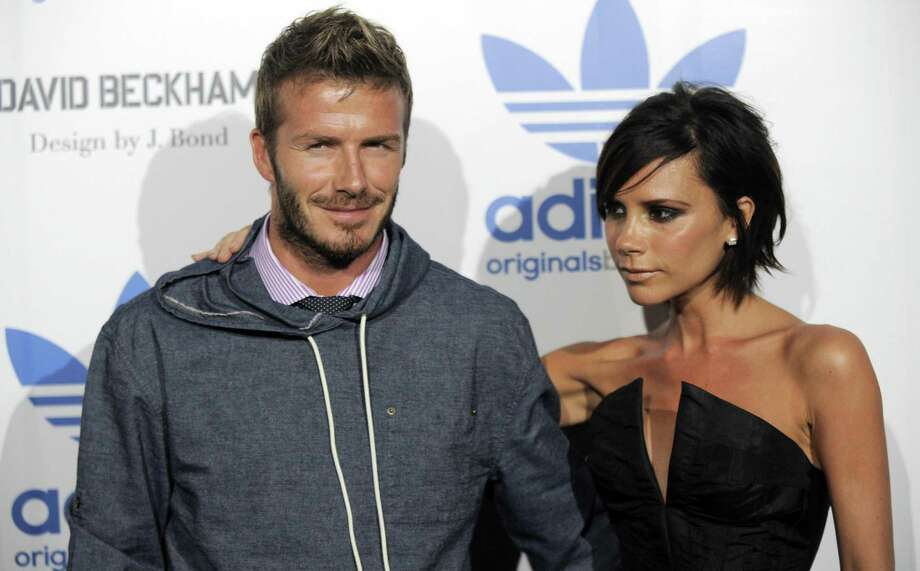 FILE - In this Sept, 30, 2009 photo, David Beckham, left, and his wife Victoria arrive at an event to celebrate the launch of the Adidas Originals by Originals David Beckham clothing line designed by James Bond,  in Los Angeles.   David Beckham and wife Victoria are expecting their fourth child, and a spokesman said Sunday that the couple has learned that it will be a girl. In January the former England captain announced via Facebook that his wife was due this summer. The pair, who married in 1999, already has three boys: 11-year-old Brooklyn, eight-year-old Romeo, and five-year-old Cruz.  (AP Photo/Chris Pizzello) Photo: ASSOCIATED PRESS / AP2009