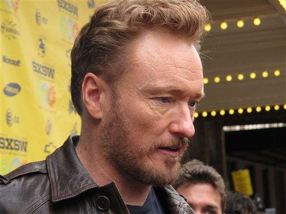 "Conan O'Brien attends  the South by Southwest premiere of ""Conan O'Brien Can't Stop,""  a documentary that captured the days after his departure from the ""Tonight Show,"" Sunday, March 13, 2011, Austin, Texas. (AP Photo/April Castro) Photo: AP / AP"