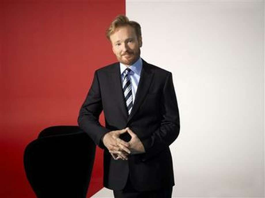 "In this undated publicity image released by TBS, TV host Conan O'Brien, is shown.  O'Brien will debut his new late night show, ""Conan,"" on Monday, Nov. 8, 2010 at 11:00 p.m. EST on TBS. (AP Photo/TBS, Art Streiber) Photo: AP / TBS"