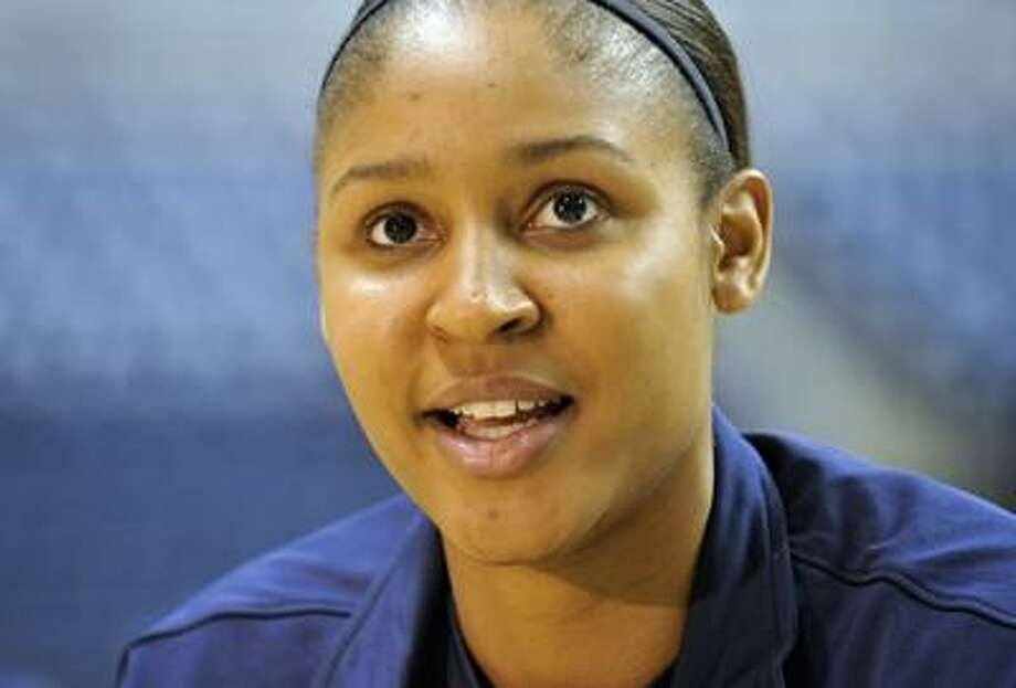 Connecticut's Maya Moore is interviewed during team's NCAA college basketball media day in Storrs Wednesday, Oct. 13. (AP) Photo: ASSOCIATED PRESS / FR125654 AP