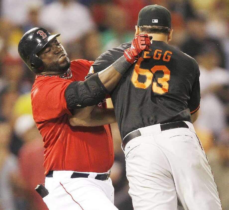 ASSOCIATED PRESS Baltimore Orioles relief pitcher Kevin Gregg (63) fights with Boston Red Sox designated hitter David Ortiz after they exchanged words after Ortiz flied out during the eighth inning of Friday's game at Fenway Park in Boston. Gregg and Ortiz were both thrown out of the game.