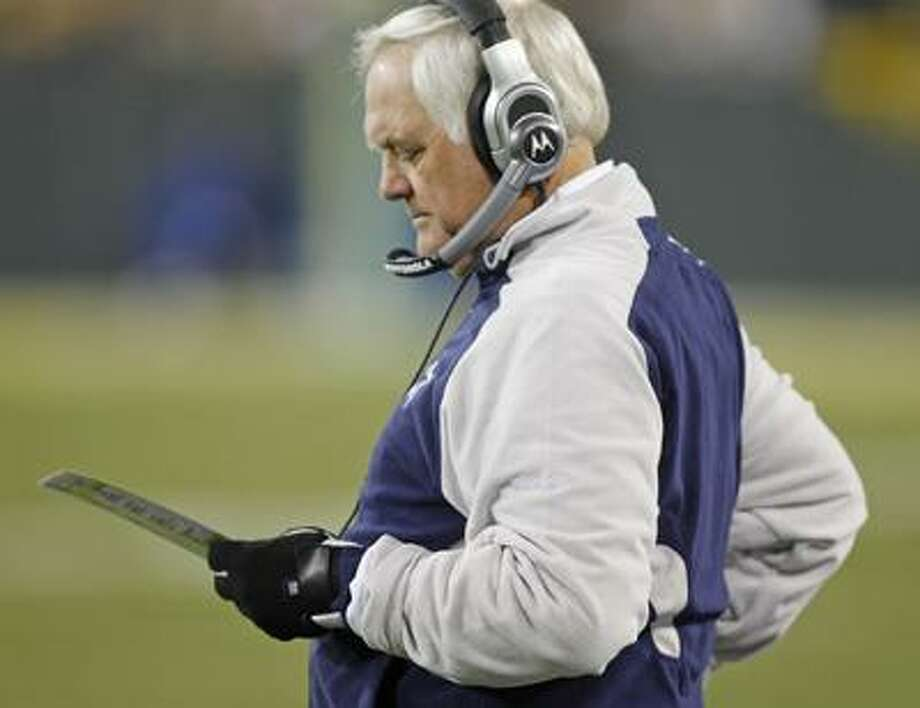 Dallas Cowboys coach Wade Phillips looks over a play list during an NFL football game against the Green Bay Packers, Sunday. (AP) Photo: ASSOCIATED PRESS / SMITJ