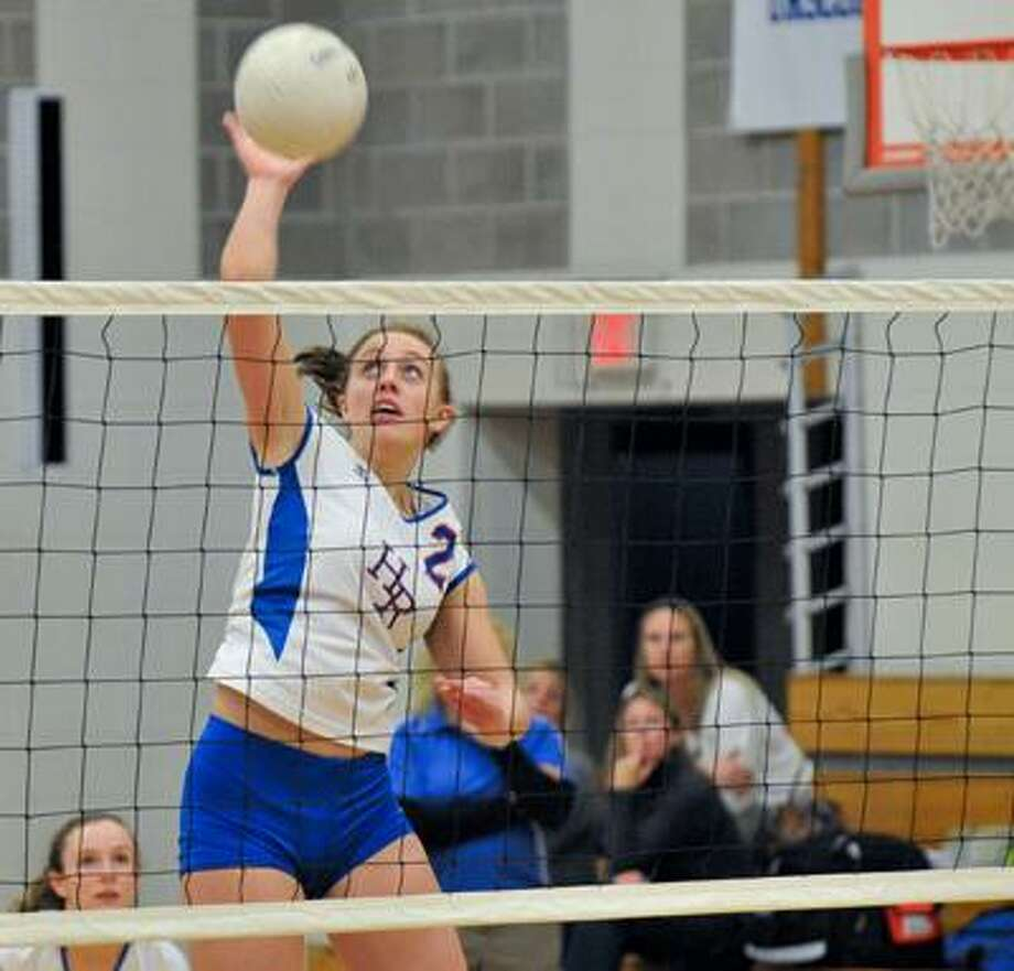 Hale Ray's Kristen Wicander drives one across the net in the first round of Class S finals against Vinal Tech, Monday night in East Haddam. The Little Noises won 3-0 and advance to tonight's game against Terryville. (Ralph Chappell / Ralph Chappell