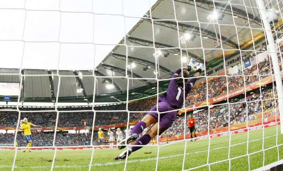 ASSOCIATED PRESS United States goalkeeper Hope Solo fails to save a shot by Sweden's Nilla Fischer during the group C match between Sweden and the United States at the Women's Soccer World Cup in Wolfsburg, Germany, Wednesday. The United States faces Brazil Saturday.