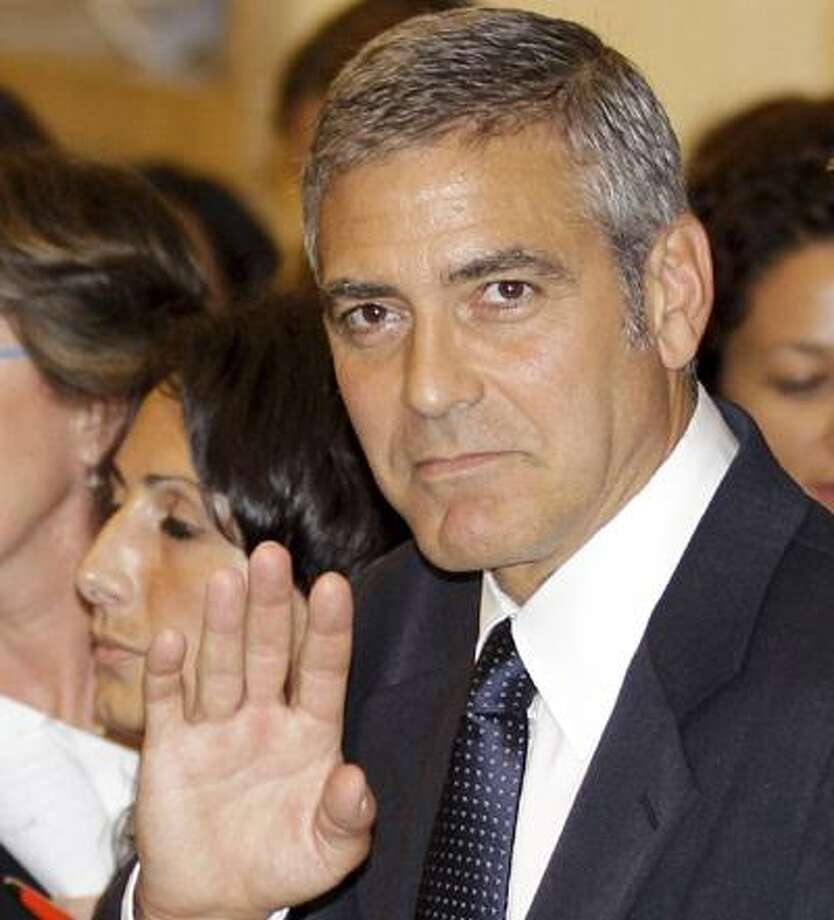 U.S. actor George Clooney leaves a tribunal in Milan, Italy, Friday, July 16, 2010. Clooney appeared in court as a witness in a fraud trial against defendants charged with co opting his name for a line of clothing. (AP Photo/Luca Bruno) Photo: ASSOCIATED PRESS / AP