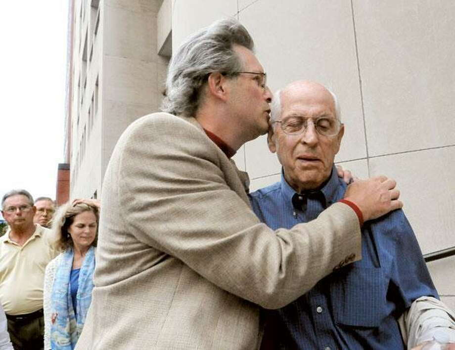 Dr. William Petit Jr., left, kisses his father-in-law, the Rev. Richard Hawke, as the two men spoke outside Superior Court in New Haven after the prosecution and defense rested their cases in the trial of Steven J. Hayes. (Melanie Stengel/Register)