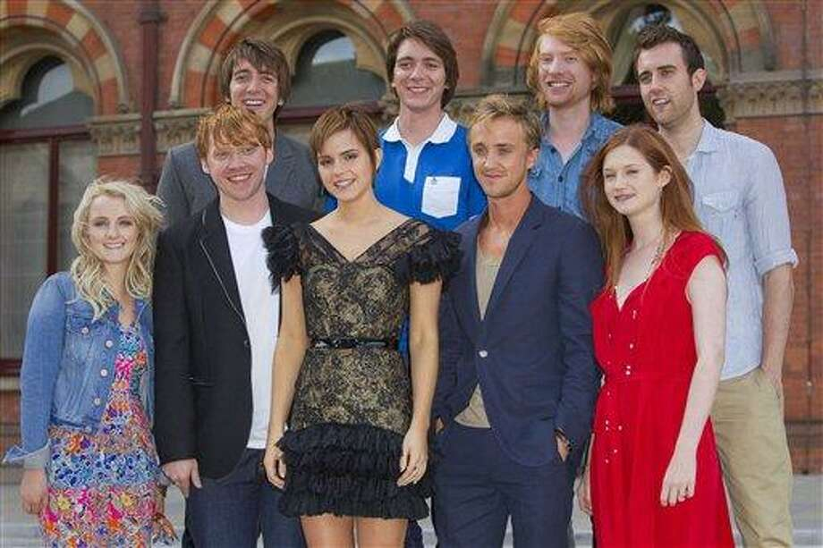 Actors, from left, back row, Oliver Phelps, James Phelps, Domhnall Gleeson, Matthew Lewis, and front row, Evanna Lynch, Rupert Grint, Emma Watson, Tom Felton, Bonnie Wright, pose at St Pancras Renaissance Hotel in central London, ahead of the world premiere of Harry Potter and The Deathly Hallows: Part 2, the last film in the series, Wednesday. (AP Photo/Joel Ryan) Photo: AP / AP