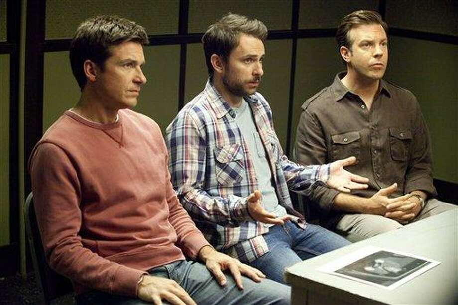 "In this film publicity image released by Warner Bros. Pictures, from left, Jason Bateman,  Charlie Day and Jason Sudeikis are shown in a scene from ""Horrible Bosses."" (AP Photo/Warner Bros. Pictures, John P. Johnson) Photo: AP / © 2011 New Line Productions Inc."