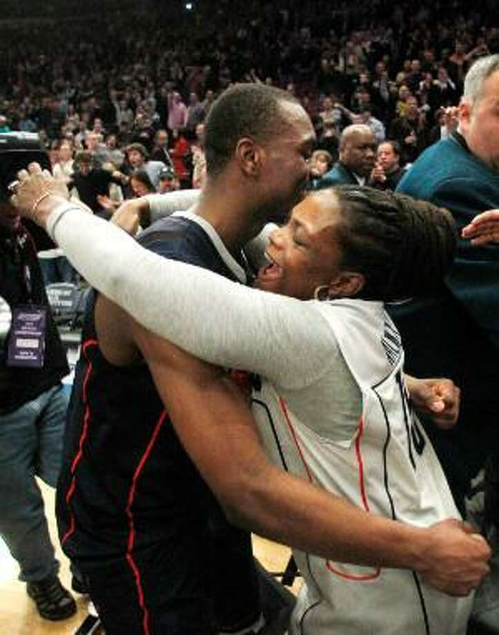AP Connecticut's Kemba Walker, left, hugs his mother, Andrea, after the Huskies won the Big East Championship final 69-66 over Louisville Saturday night at Madison Square Garden in New York. UConn is a No. 3 seed in the West Region of the NCAA Tournament and will face No. 14 Bucknell Thursday in Washington, D.C..