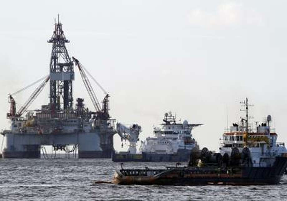 Vessels assisting in the capping of the Deepwater Horizon oil wellhead are seen on the Gulf of Mexico near the coast of Louisiana Friday, July 16, 2010. (AP Photo/Patrick Semansky) Photo: ASSOCIATED PRESS / FR158704 AP