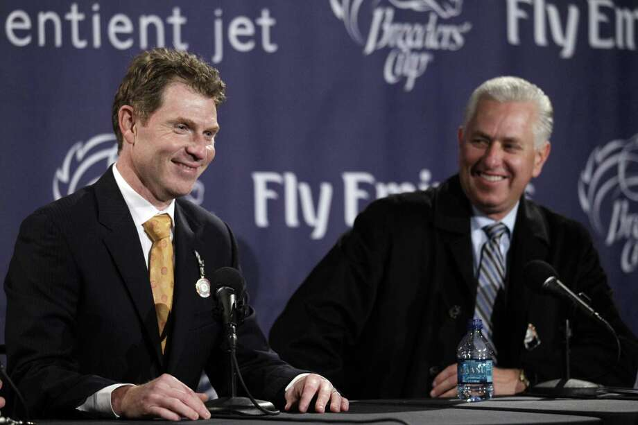Owner Bobby Flay, left and trainer Todd Pletcher laugh as they talk about their horse More Than Real winning the Marathon race at the Breeder's Cup horse races at Churchill Downs Friday, Nov. 5, 2010, in Louisville, Ky. (AP Photo/Morry Gash) Photo: ASSOCIATED PRESS / AP