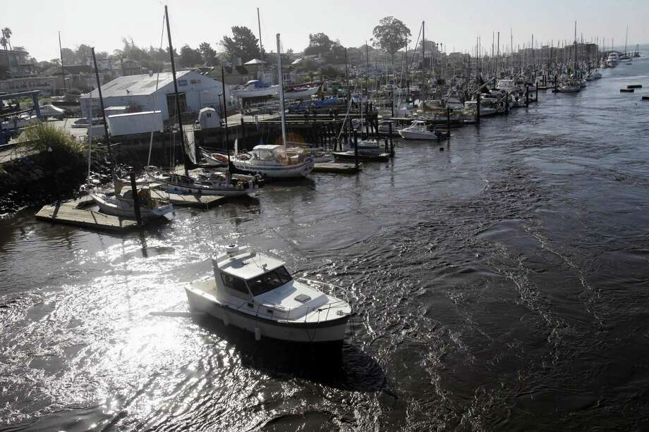 A boat is carried by a tsunami surge on the harbor in Santa Cruz, Calif., Friday. A tsunami caused by an earthquake in Japan resulted in warnings as far away as the United States' west coast.  (AP Photo/Marcio Jose Sanchez) Photo: ASSOCIATED PRESS / AP2011