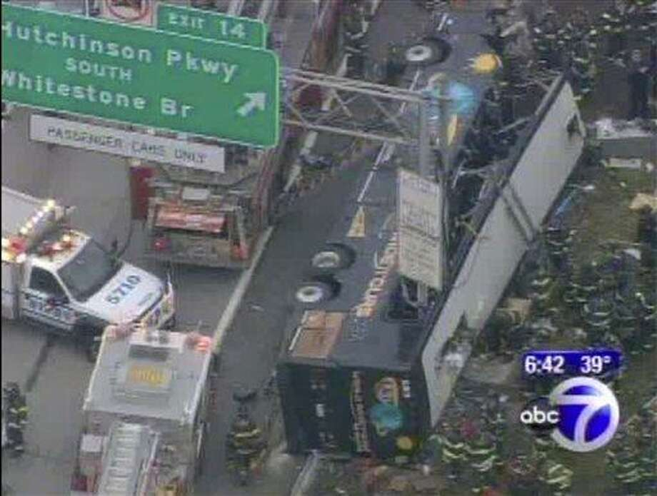 This image provided by ABC-TV shows the World Wide Tours tour bus after it was sliced by the exit sign on Interstate 95 south in the Bronx borough of New York early Saturday morning March 12, 2011. Officials say 13 people have died. Officials say 13 people have died. A New York Fire Department spokesman says the bus was carrying 31 to 33 passengers. He says in addition to the fatalities, six passengers were critically injured and four have been transported to hospitals. The spokesman says 11 others sustained minor injuries. (AP Photo/ABC) Photo: AP / ABC