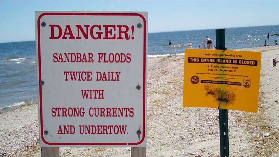 A sign at Silver Sands State Park says warns beachgoers of strong currents near the sandbar. (Mark McCurley/For the Register)
