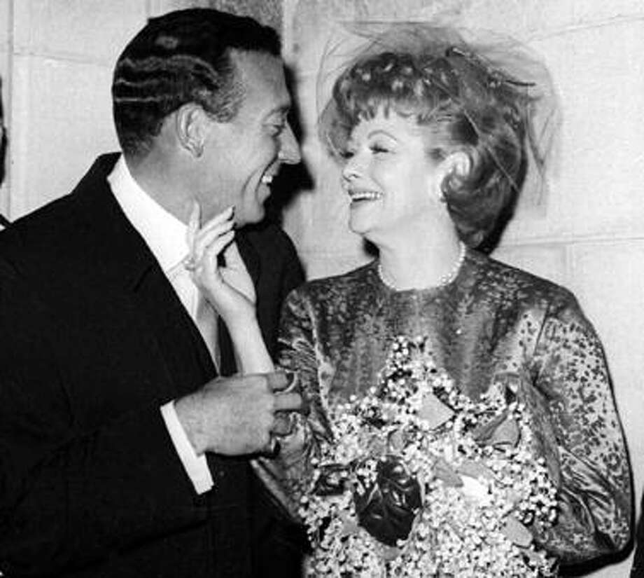 FILE - In this Nov. 20, 1961 file photo, Gary Morton, left, and Lucille Ball pose after their wedding at the Marble Collegiate Church in New York.  (AP Photo, file) Photo: ASSOCIATED PRESS / AP