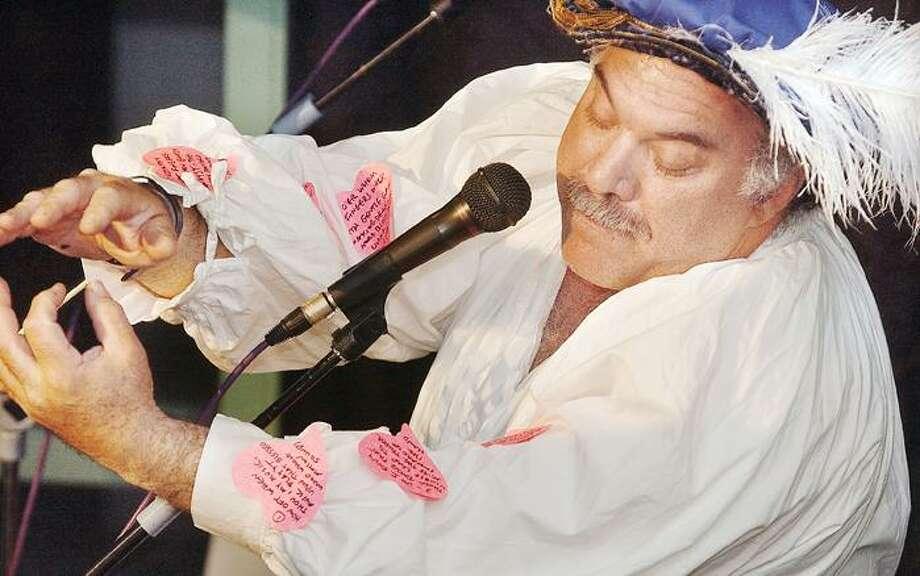 Paul Hammer performs at ARTFARM's Sonnet Slam at Kidcity Museum in Middletown Thursday evening. (Catherine Avalone)