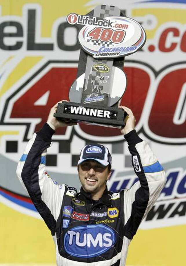 NASCAR Sprint Cup Series driver David Reutimann celebrates with the trophy in Victory Lane after winning the LifeLock 400 auto race at ChicagoLand Speedway in Joliet, Ill., Saturday, July 10. (AP) Photo: ASSOCIATED PRESS / AP