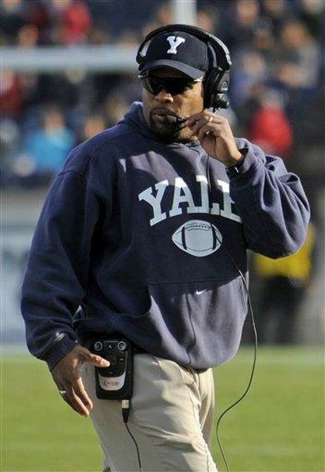 Yale head coach Tom Williams walks on the field during the first half of an NCAA college football game against Harvard at Yale Bowl in New Haven, Conn., Saturday, Nov. 19, 2011.  (AP Photo/Bob Child) Photo: ASSOCIATED PRESS / AP2011