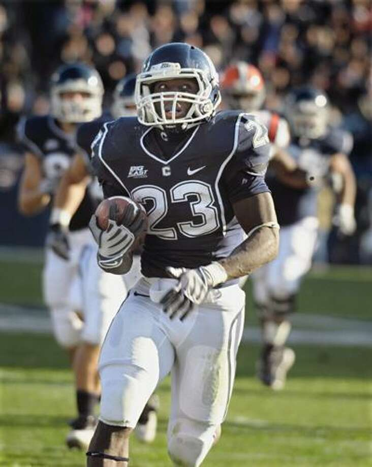 Connecticut's Jordan Todman (23) runs for a touchdown against Syracuse during the first half of an NCAA college football game at Rentschler Field in East Hartford, Saturday, Nov. 28, 2009. (AP) Photo: ASSOCIATED PRESS / AP2009