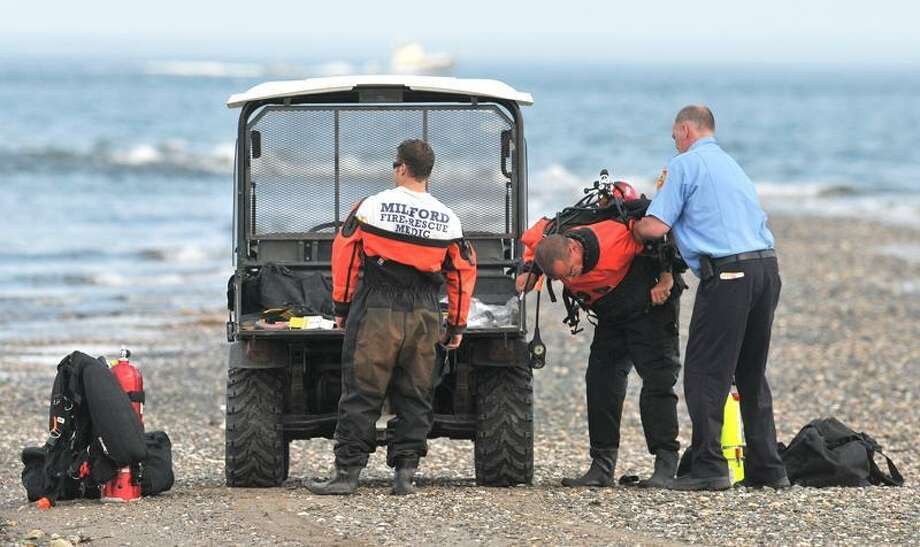 Milford Fire Rescue divers search for a missing swimmer at Silver Sands Monday afternoon. (Brad Horrigan/Register)