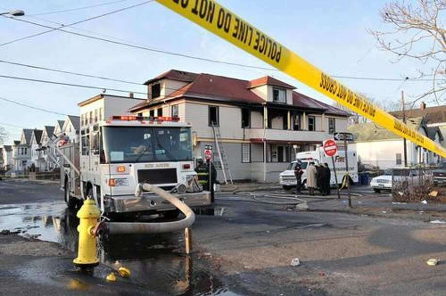 Three died in Wednesday morning's fire at this house on the corner of Poplar and Wolcott streets. (Brad Horrigan/New Haven Register)