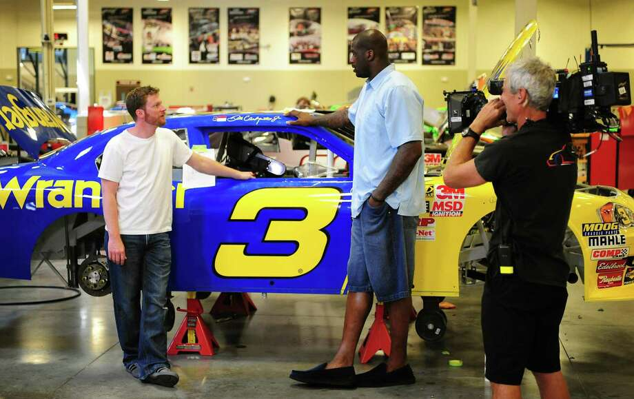 "NASCAR Sprint Cup Series driver Dale Earnhardt Jr. , left, and NBA basketball star Shaquille O'Neal tape a segment of ""Shaq Vs."" on Tuesday, June 22, 2010, at JR Motorsports in Mooresville, N.C. The two are scheduled battle one another on the track at Concord Speedway on Wednesday. (AP Photo/The Charlotte Observer, Jeff Siner) Photo: ASSOCIATED PRESS / The Charlotte Observer"