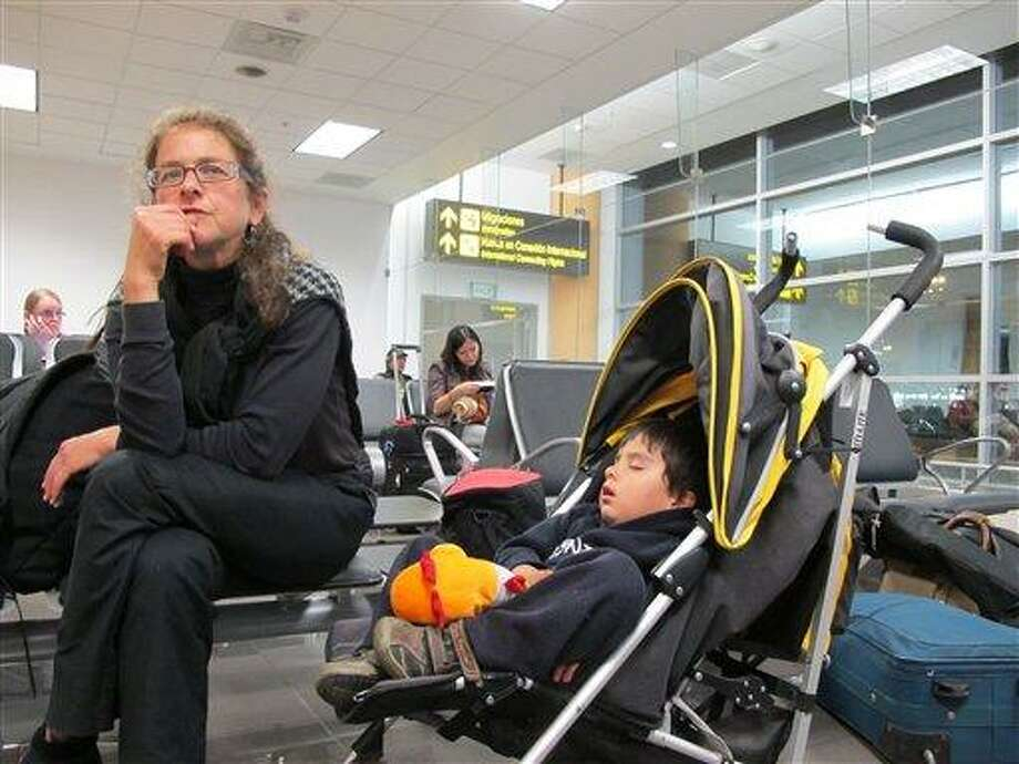 Paroled U.S. activist Lori Berenson, accompanied by her son, Salvador Apari, waits at the international airport before boarding a plane to the U.S. in Lima, Peru, Monday.  Associated Press Photo: AP / AP