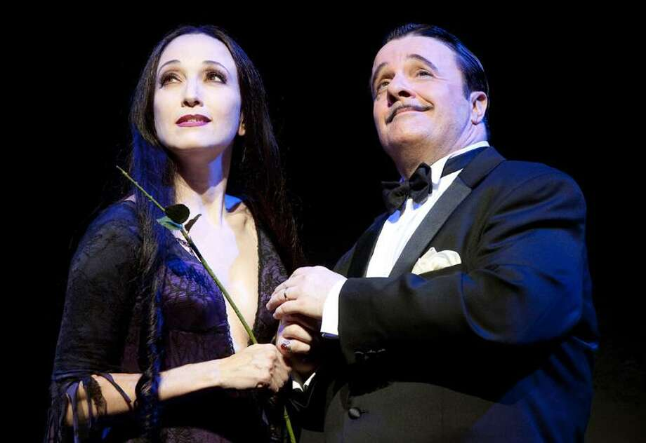 "In this theater publicity image released by The Publicity Office, Bebe Neuwirth, left, and Nathan Lane are shown in a scene from ""The Addams Family,"" now playing at Broadway's Lunt-Fontanne Theatre in New York. (AP) Photo: AP / ©2009, Joan Marcus"